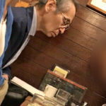 Mr. Yoichi Okada earnestly studying and absorbing the teachings of a particular religious group (a Christian cult group).